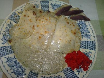 "Raviolis ""Osnofla"" rellenos de higado de pato y salsa de trufa negra."